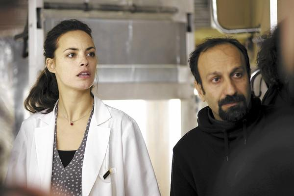 "Berenice Bejo and Asghar Farhadi in ""The Past."""