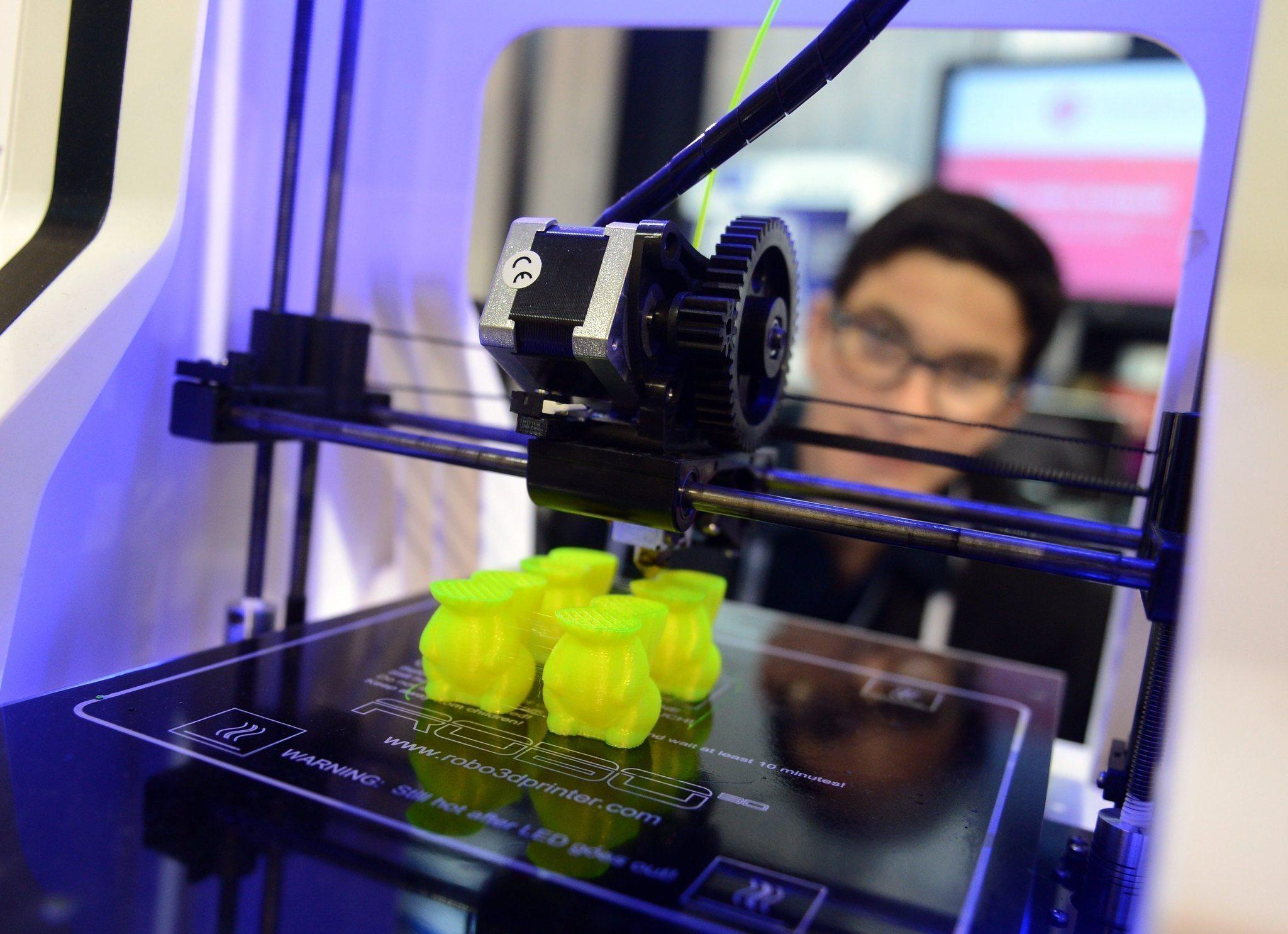 Items are printed with a 3D printer at the Robo3D company stand at the 2014 Consumer Electronics Show in Las Vegas.