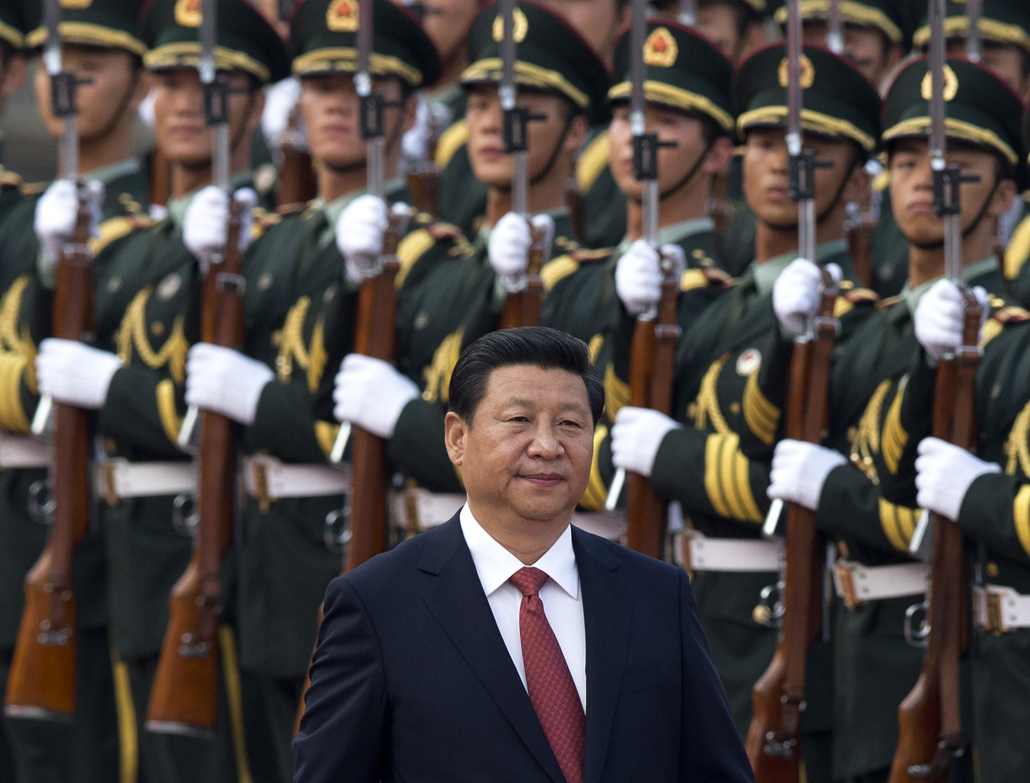 Chinese President Xi Jinping inspects a guard of honor outside the Great Hall of the People in Beijing.