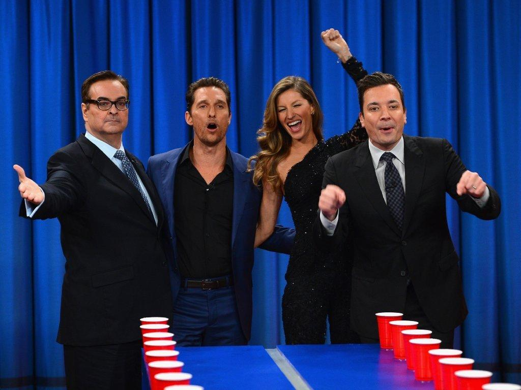 """Jimmy Fallon, right, shown with comedian Steve Higgins, left, actor Matthew McConaughey and model Gisele Bundchen on the set of """"Late Night,"""" is taking over NBC's """"Tonight Show"""" in February."""