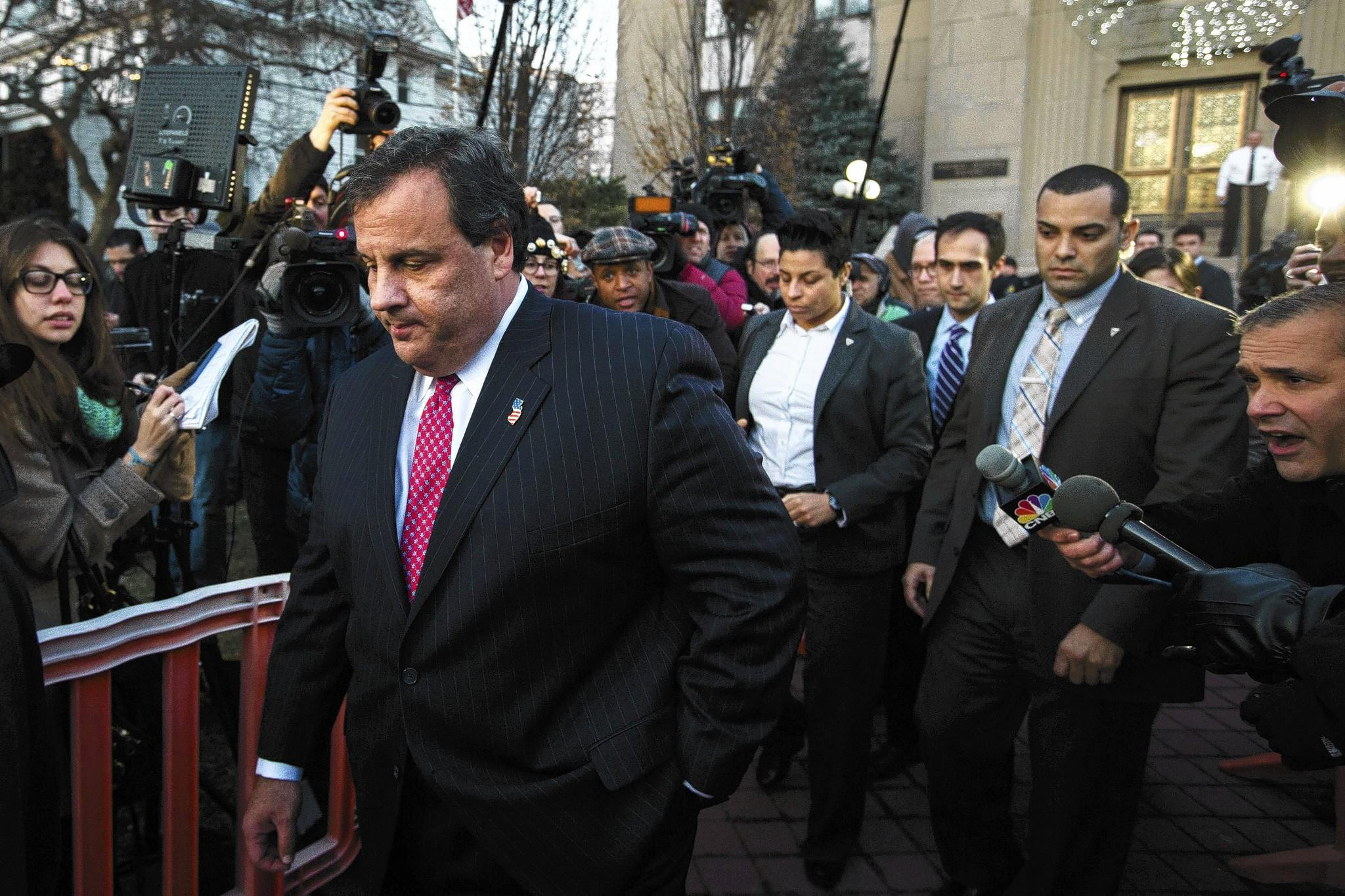 New Jersey Gov. Chris Christie, left, leaves City Hall in Fort Lee, N.J., after meeting Thursday with the city's Democratic mayor to apologize for a traffic snarl apparently caused by Christie's staff.