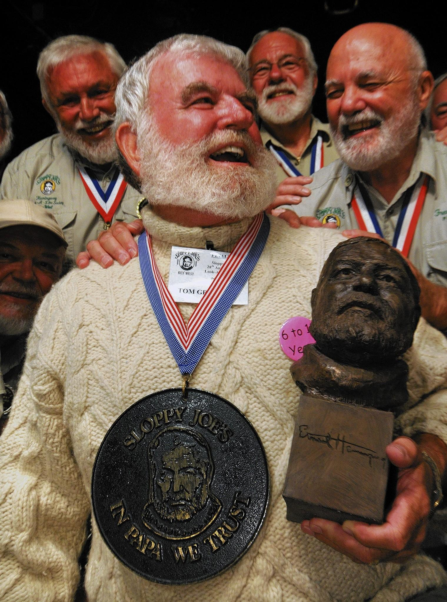 "Tom Grizzard of Leesburg, Florida, is congratulated by previous winners after winning the 2008 ""Papa"" Hemingway Look-Alike Contest at Sloppy Joe's Bar July 19, 2008 in Key West, Florida."