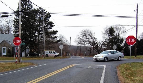 Two oversize stop signs are posted in each direction on two-way State Road at Richlandtown Pike in Springfield Township, but the intersection does not meet the warrants for traffic signals.