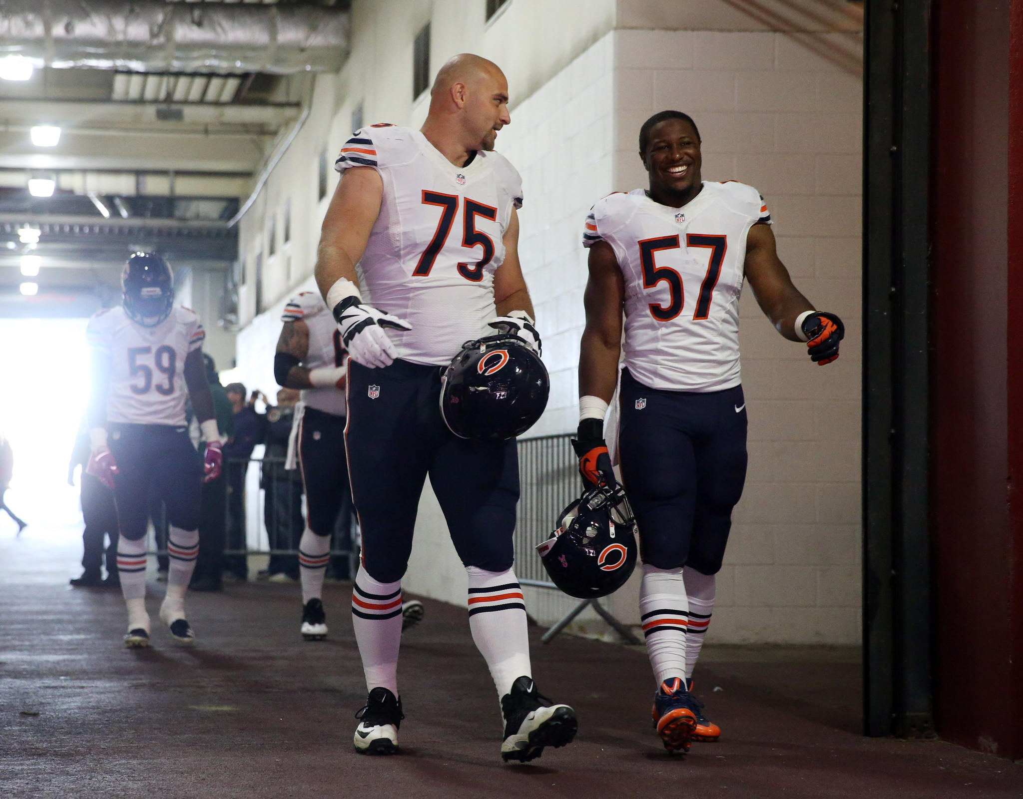 Bears offensive guard Kyle Long and linebacker Jon Bostic take the field.