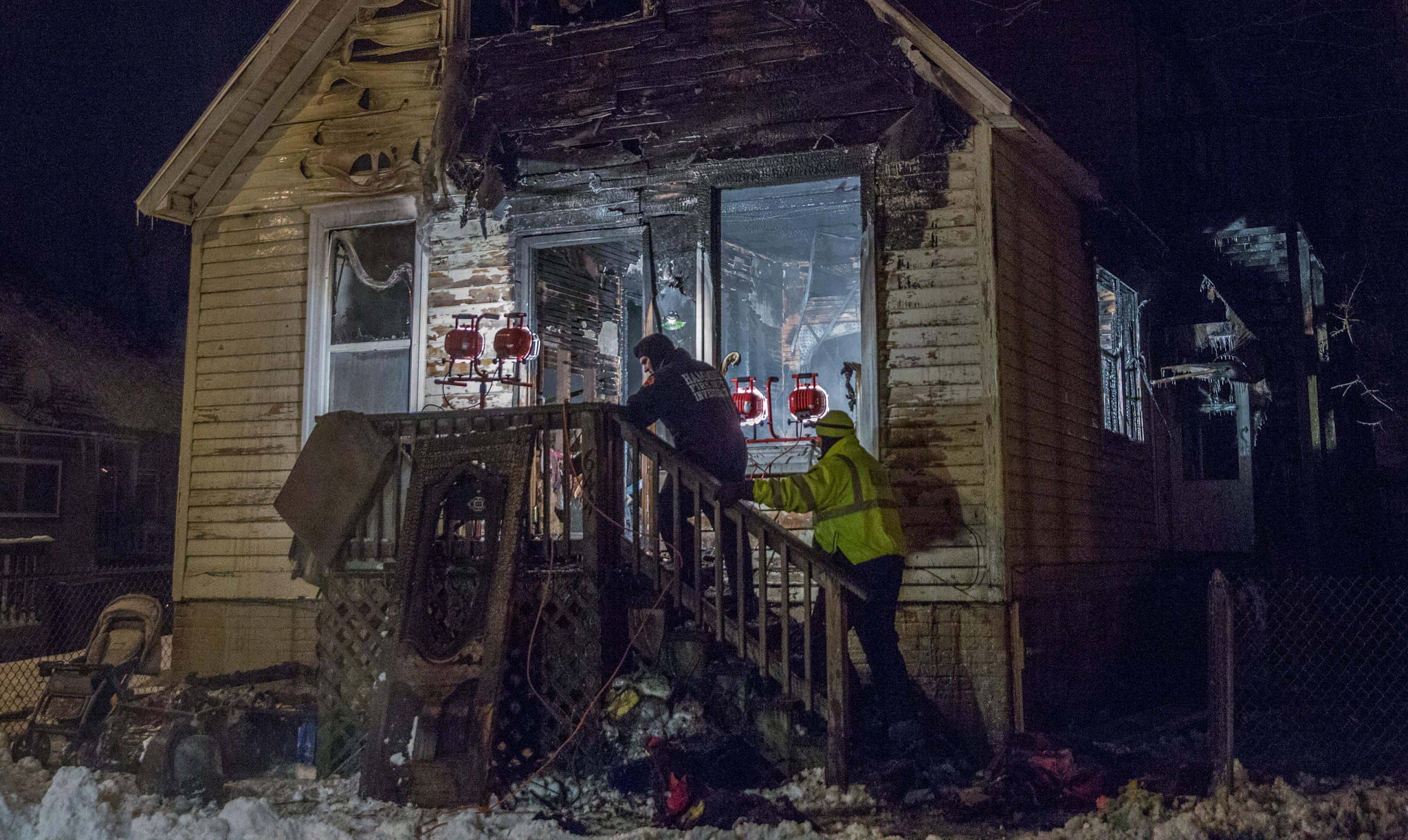 Hammond Fire Department officials investigate the house in the 600 block of Sibley Street in Hammond where three children died Thursday.