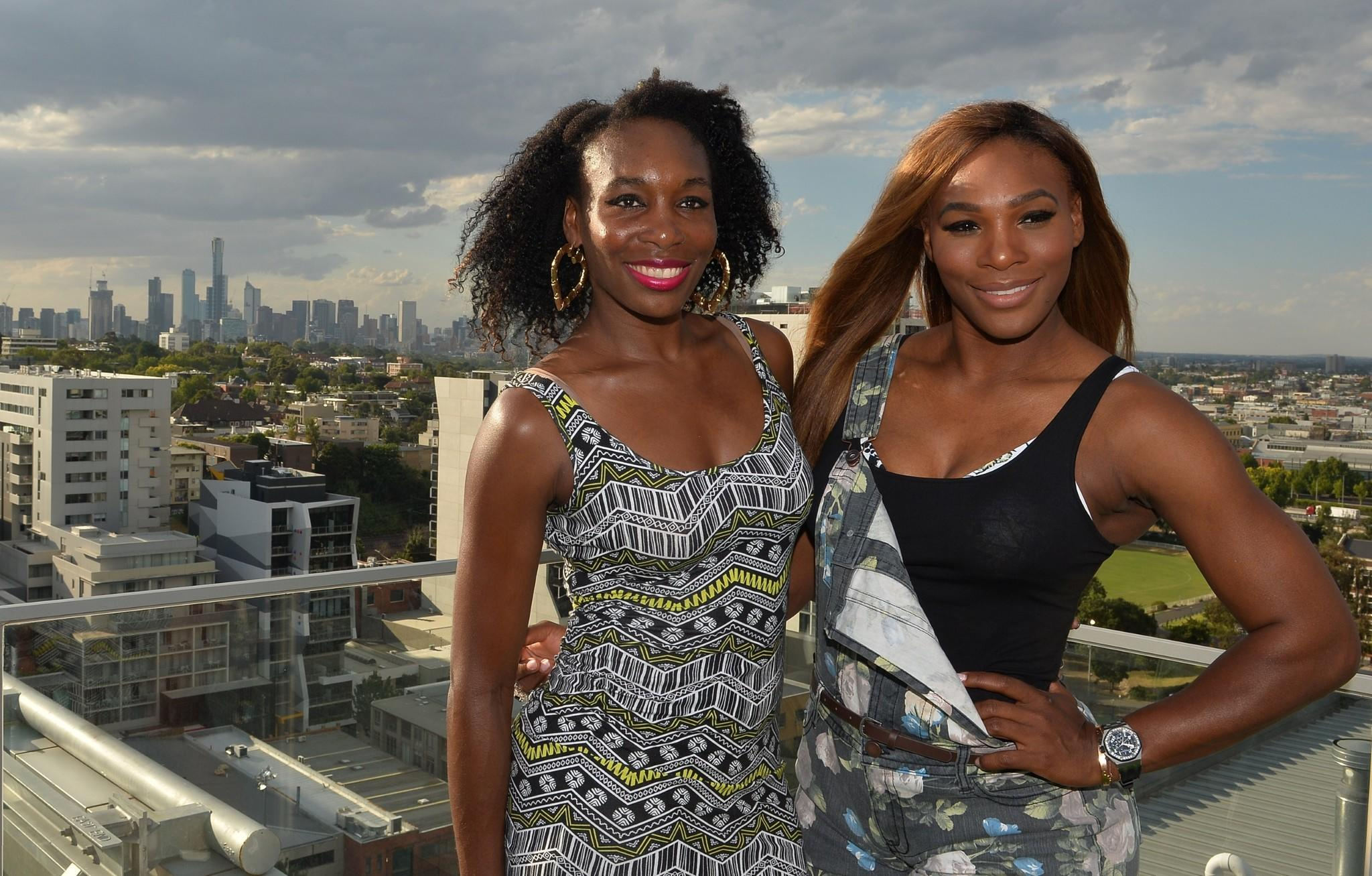 Serena Williams and sister Venus pose for a portrait on the rooftop of a city hotel during a media event for the upcoming Australian Open in Melbourne.