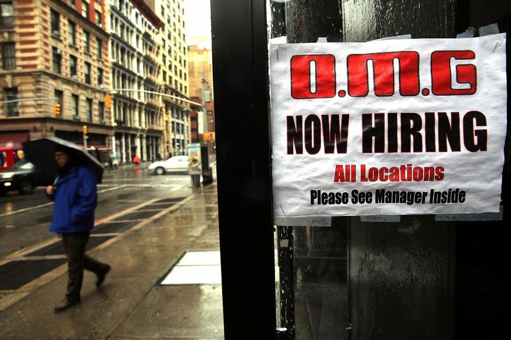 A sign in a window at a New York City retail store advertises for a job opening last month.