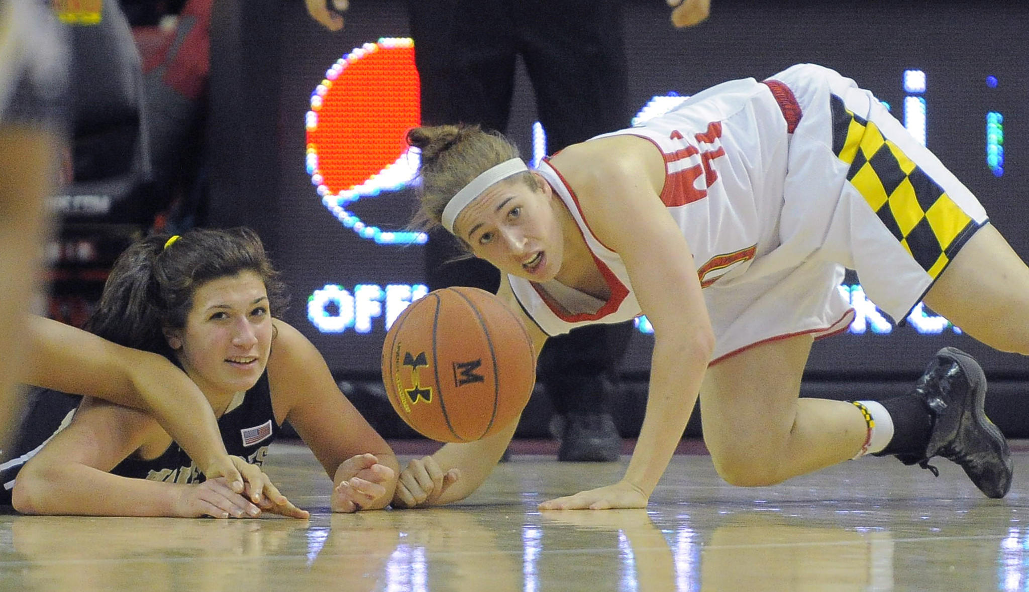 A loose ball slapped by Maryland guard Katie Rutan, right, bounces away from Wake Forest Demon Deacons guard Jill Brunori (left) during the first half Thursday.