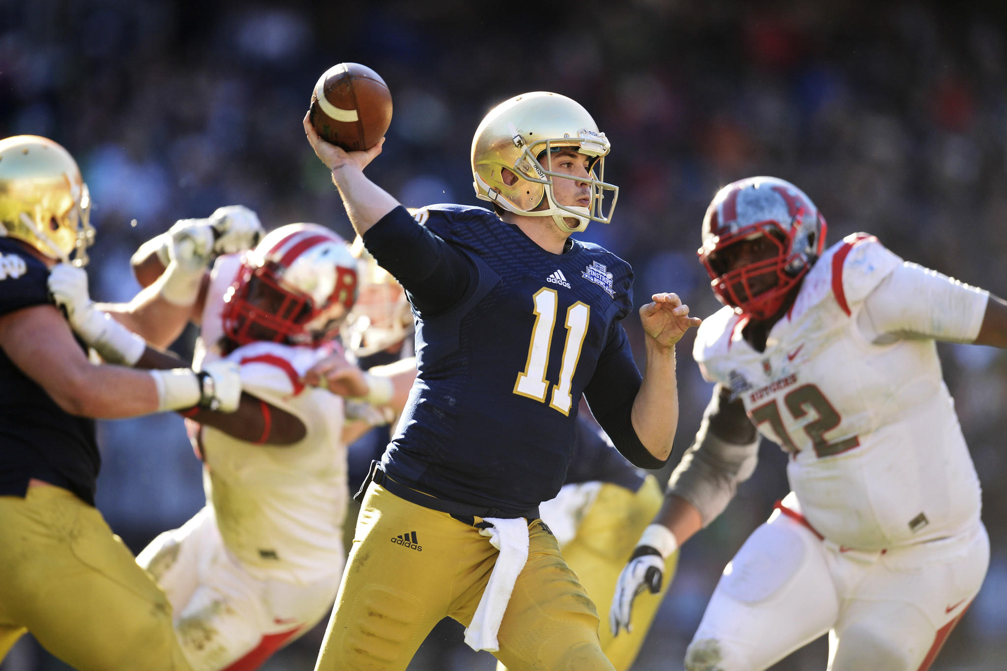 Notre Dame Fighting Irish quarterback Tommy Rees throws a pass against the Rutgers Scarlet Knights during the first half of the Pinstripe Bowl at Yankees Stadium.