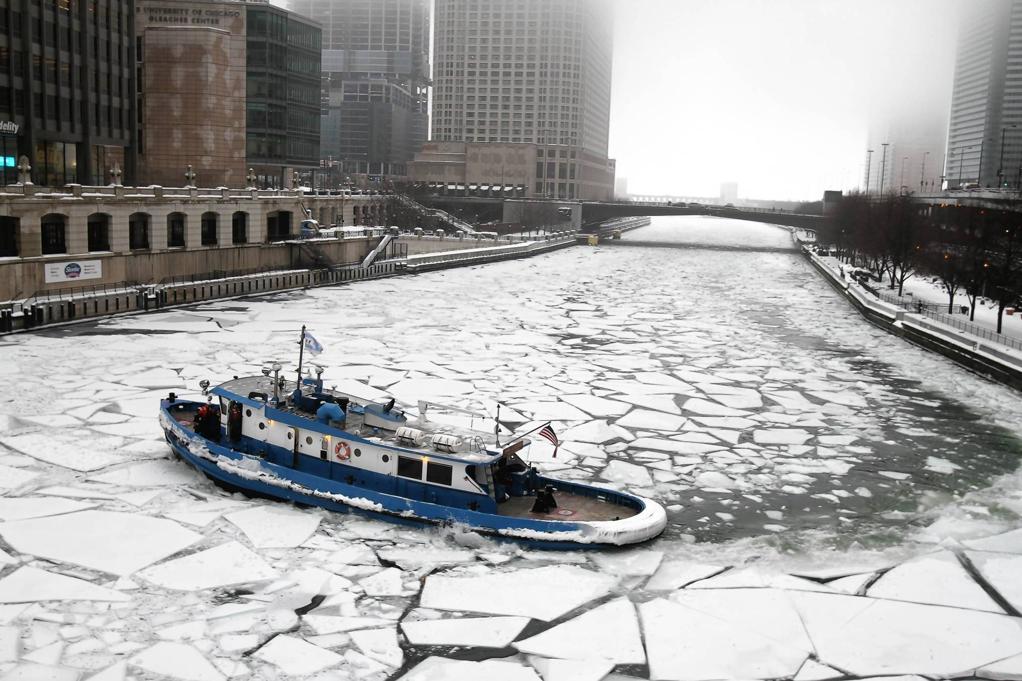 The James J. Versluis ice-breaking tug breaks up ice on the Chicago River near the North Michigan Avenue bridge.