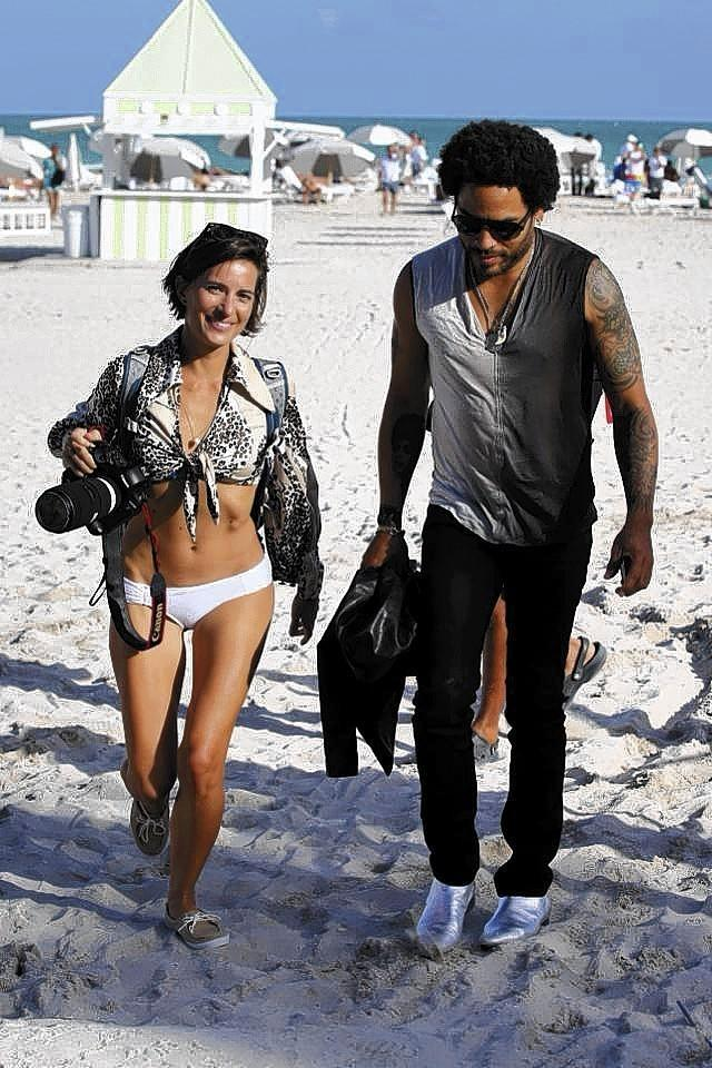 Photographer Logan Fazio is photographed while walking with rocker Lenny Kravitz in South Beach.