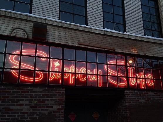 Slippery Slope's neon sign, visible from Milwaukee Avenue.