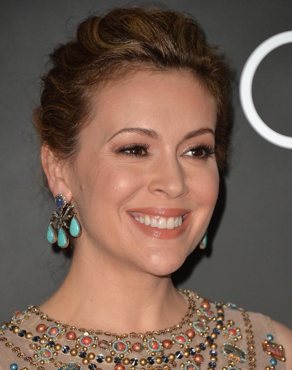 Actress Alyssa Milano arrives to Audi Celebrates Golden Globes Weekend at Cecconi's Restaurant on January 9, 2014 in Los Angeles, California.