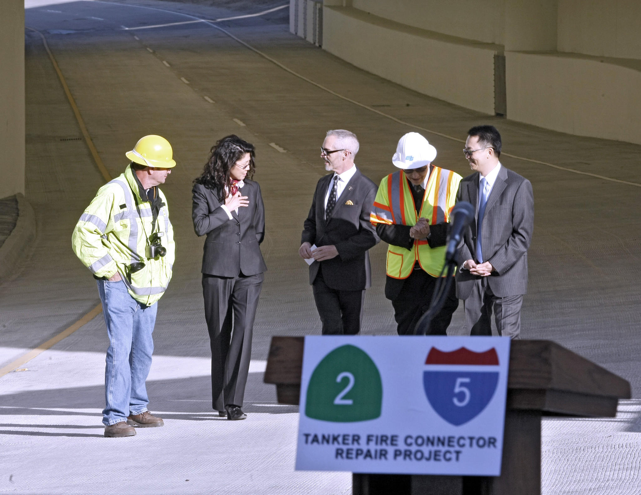 Officials walk the northbound Glendale SR-2 freeway connector to the northbound Golden State I-5 freeway in Echo Park that was completed and reopened by the California Department of Transportation on Friday, January 10, 2014. Known as the 2/5 Tanker Fire Connector Repair Project, it took six months for this section of the tunnel to reopen after the July 13, 2013 accident where a gasoline tanker flipped over and caught fire.