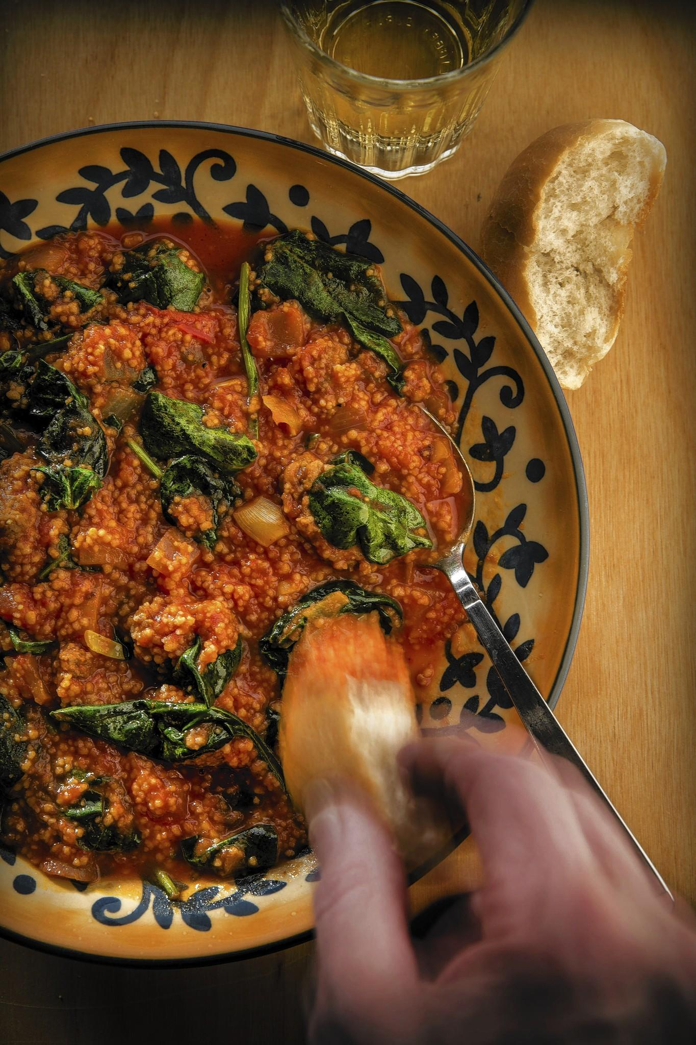 Finished dish photo of spinach with couscous.