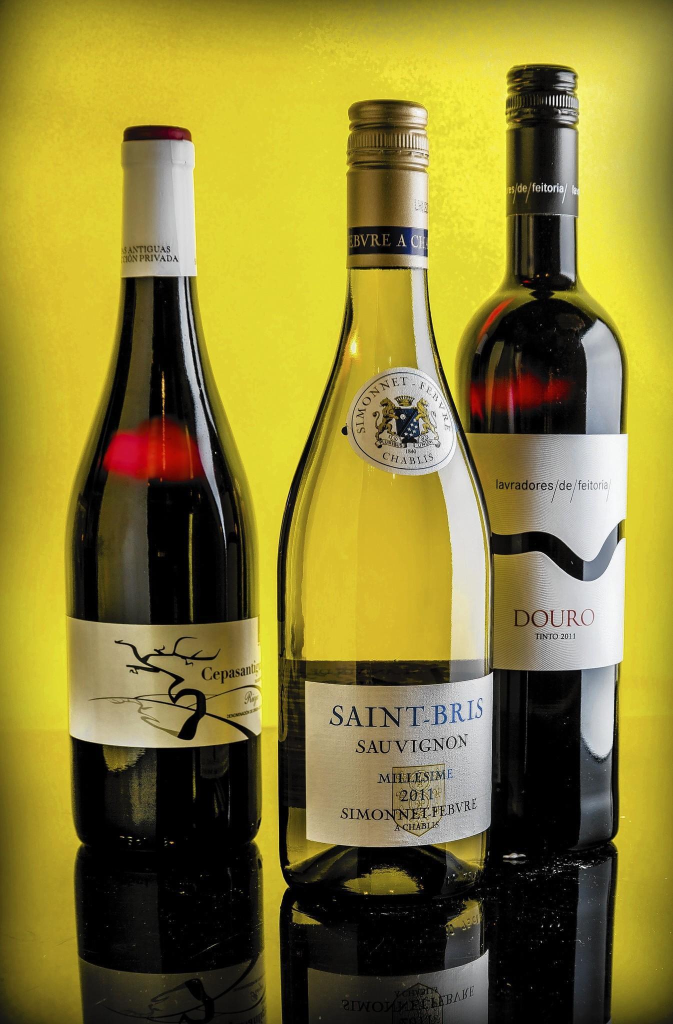 Still life of three bottles of wine.