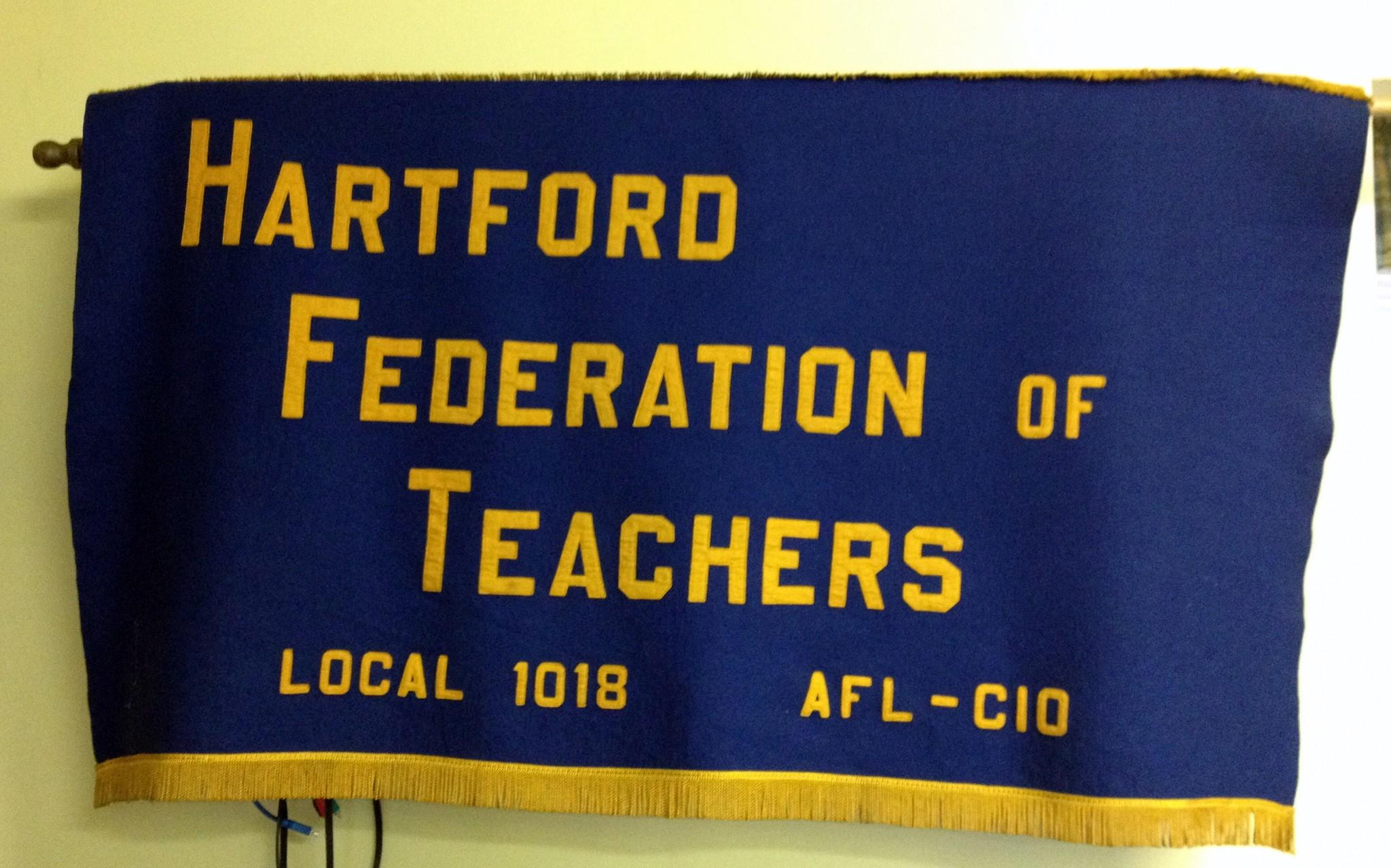 A banner for the Hartford Federation of Teachers hangs on the wall inside union headquarters.