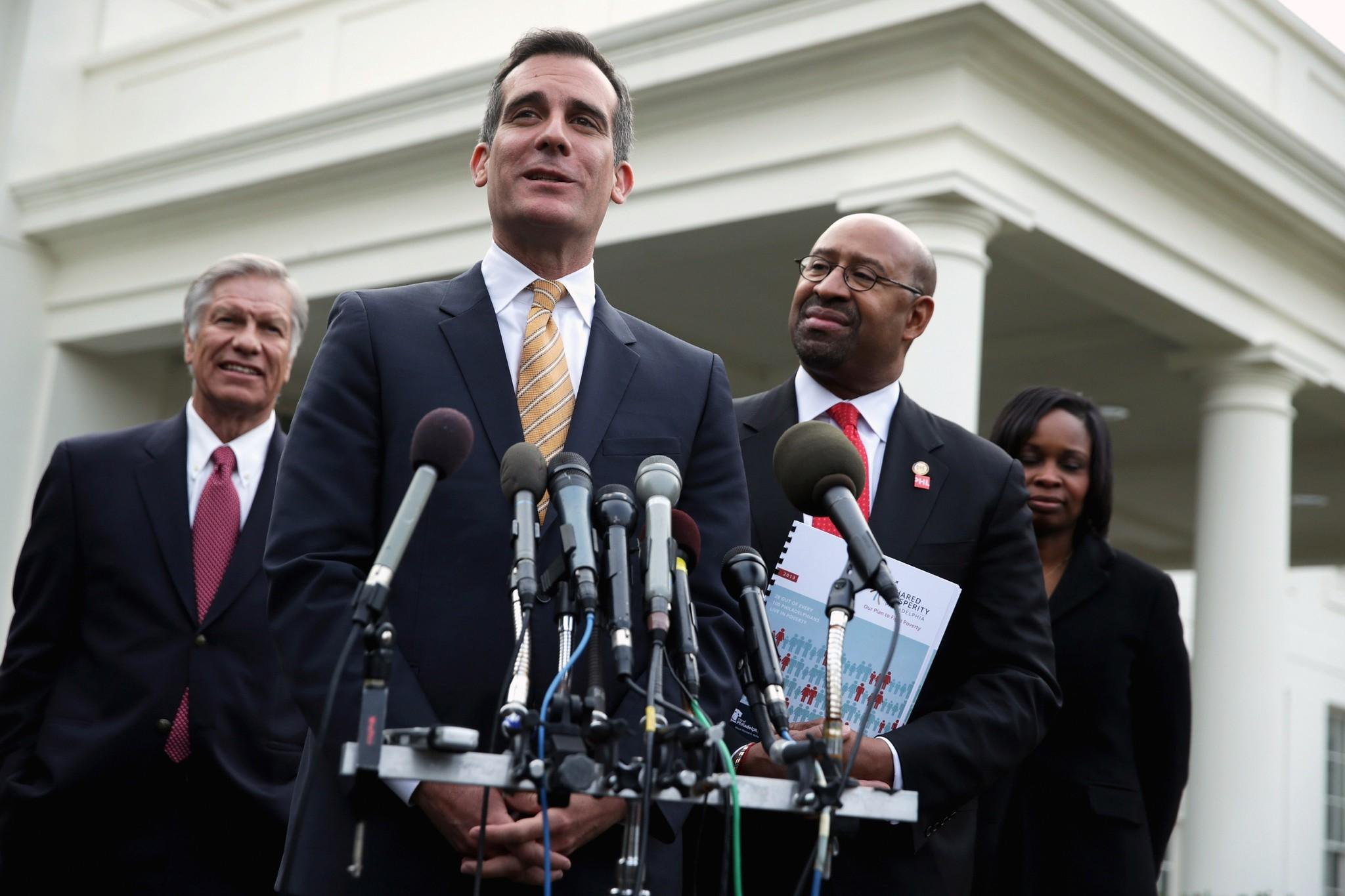 Philadelphia Mayor Michael Nutter, third from left, Los Angeles Mayor Eric Garcetti, speaking, and Chief Gregory Pyle of the Choctaw Nation of Oklahoma, meet members of the media after a White House event where President Obama announced the creation of Promise Zones.