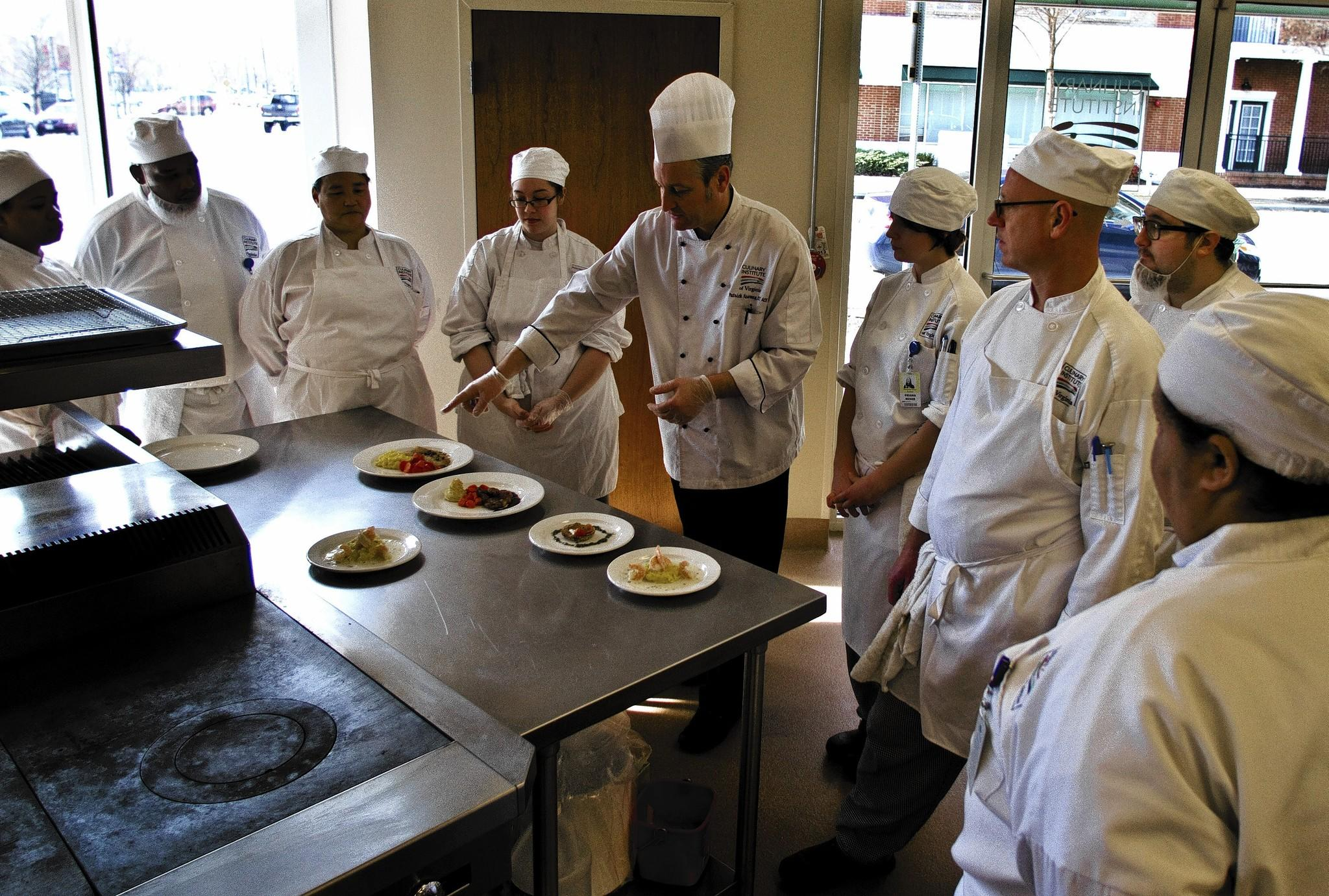 (Center) Chef Patrick Kearney goes over the dishes the students have completed today in class. Culinary Institute of Virginia's opened its Newport News campus earlier this year on the ground floor of City Center in Newport News.
