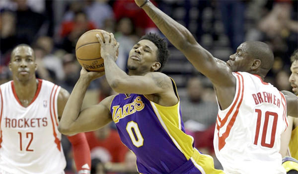 Nick Young looks to pass during the Lakers' loss to the Rockers, 113-99, on Wednesday. The Lakers had won one game in their last 10 before a matchup with the Clippers on Friday.