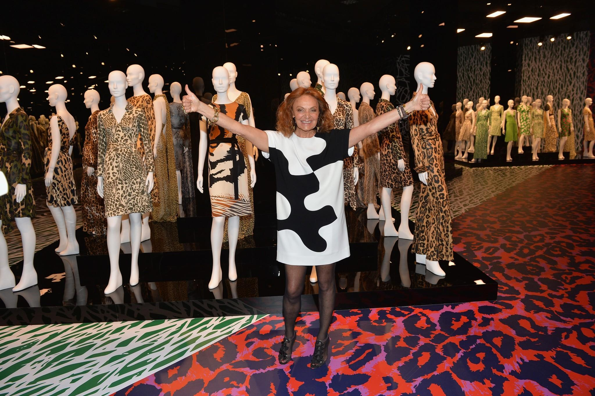 Designer Diane von Furstenberg with a collection of her wrap dress designs.