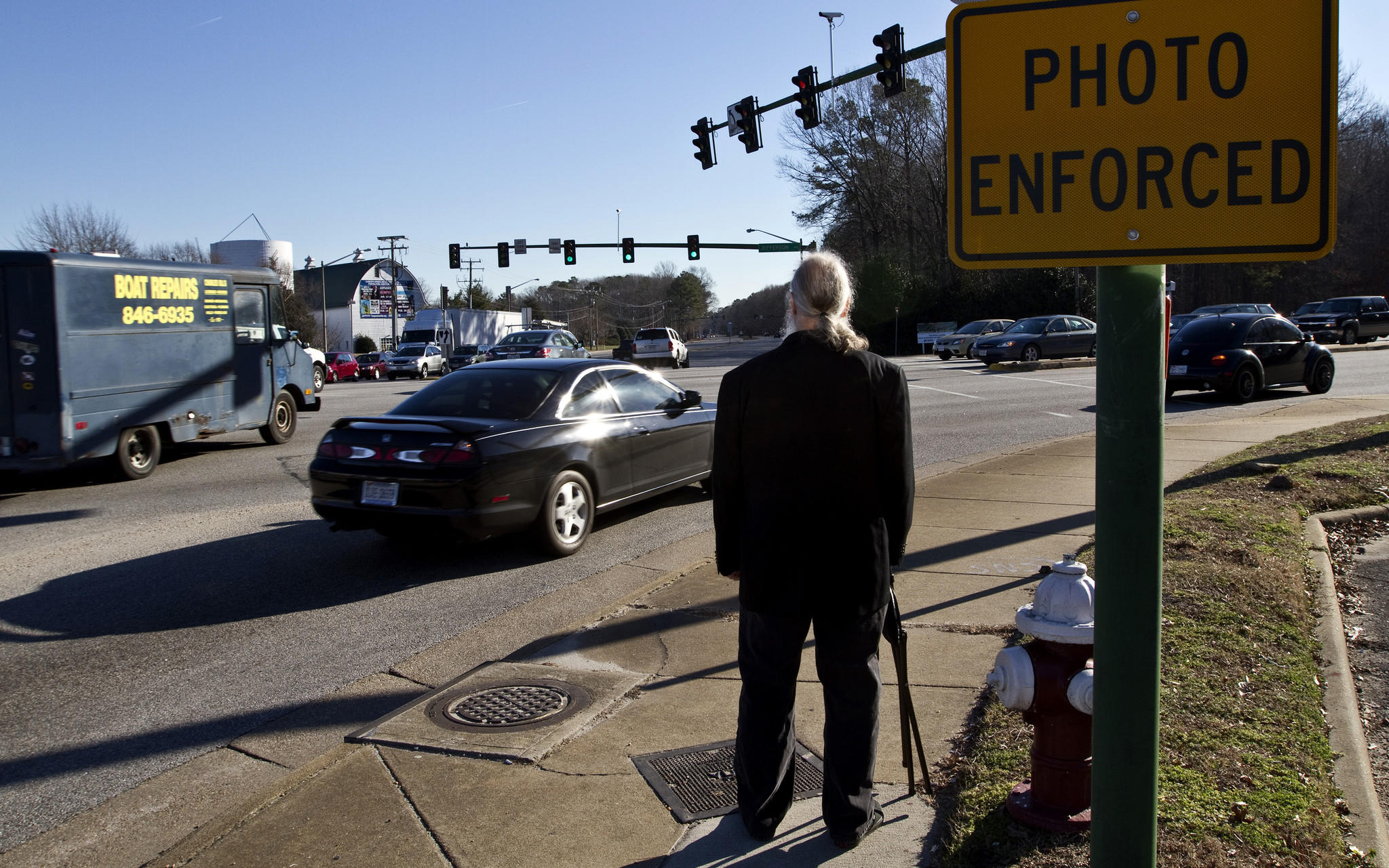 Rick Ray Johnson, shown in photo,59, is asking a judge to rule that the enforcement of the red-light camera code is unconstitutional and to strike the evidence against him.