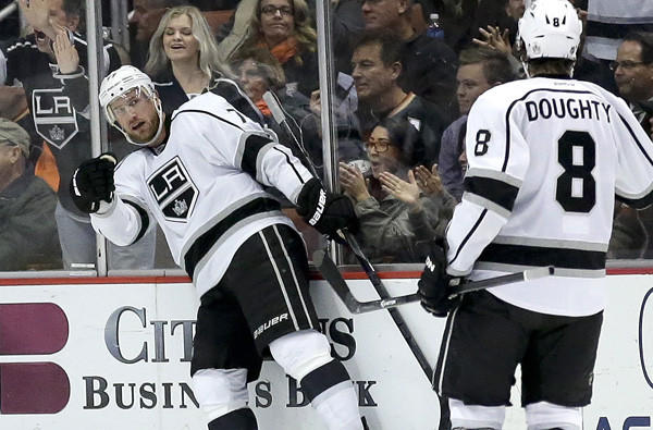Kings center Jeff Carter celebrates a goal with defenseman Drew Doughty during a game against the Ducks earlier this season in Anaheim.