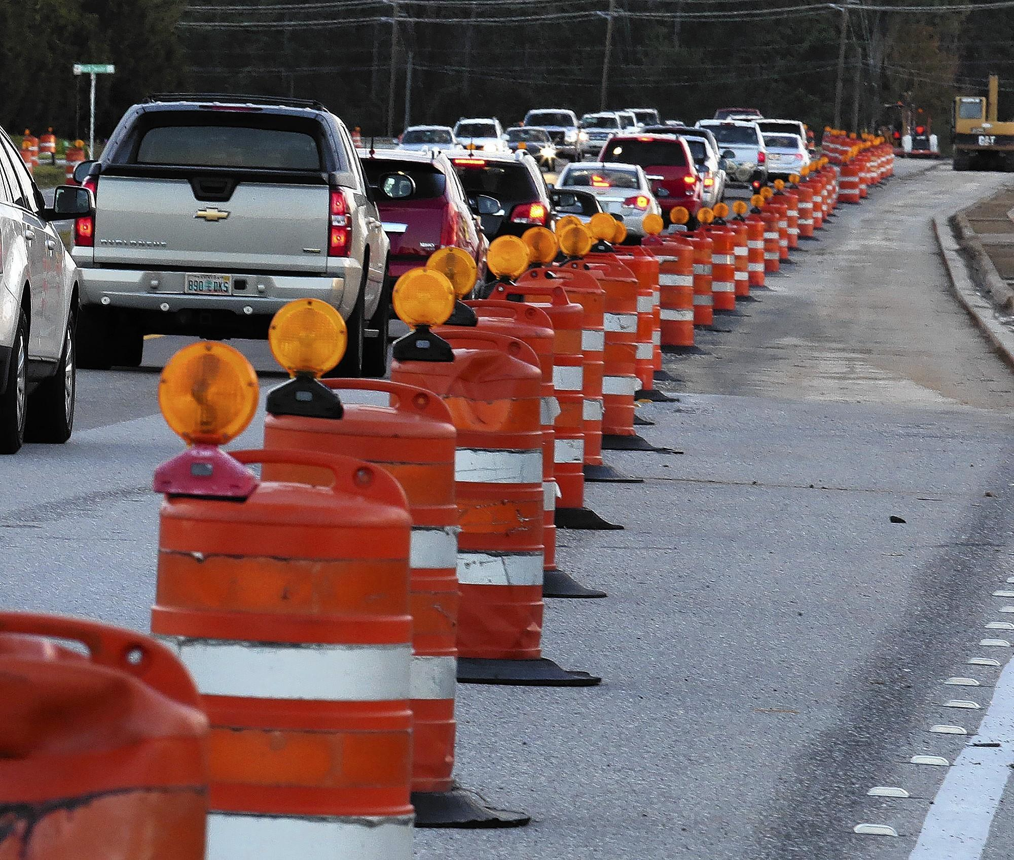 Traffic drives southbound through a construction zone on Alafaya Trail south of the 408 on Friday, January 10, 2014.