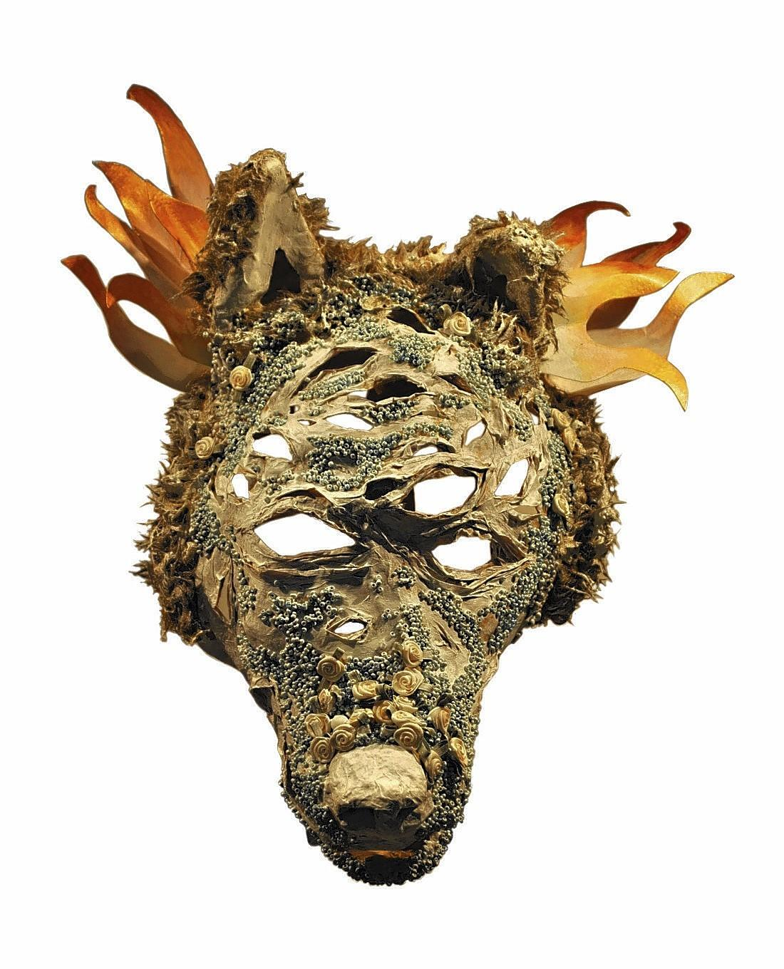 "This mask by Linda Hall is part of the ""Crossing Over"" exhibit."