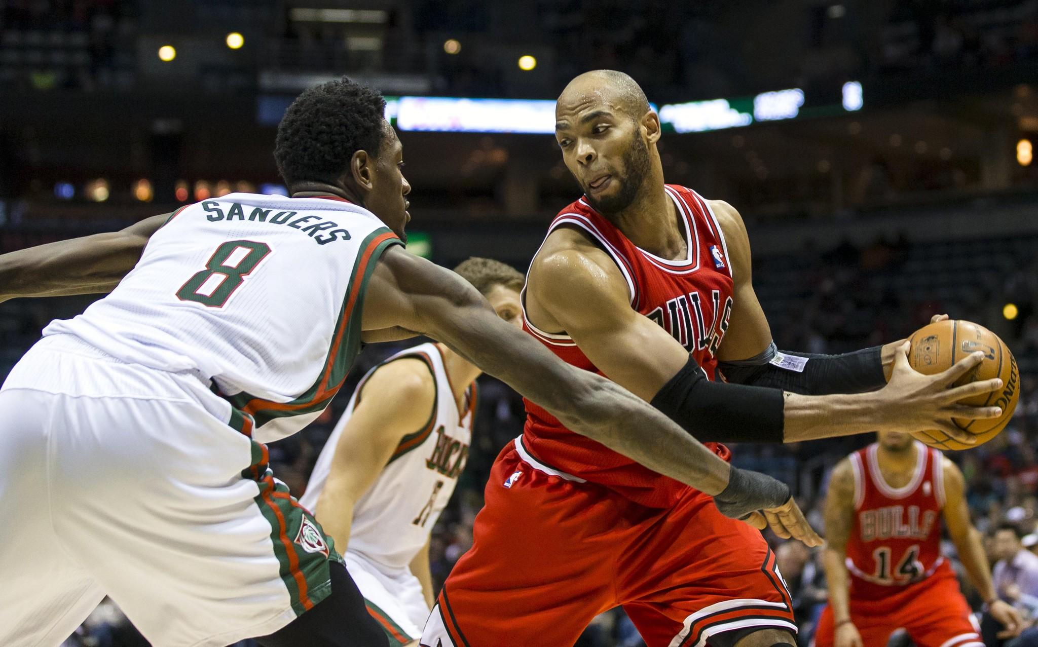 Bulls forward Taj Gibson gets ready to make a move on Bucks center Larry Sanders.