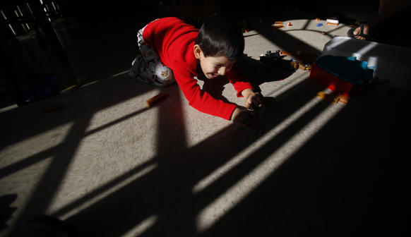 Nathan Salazar, 4, plays in the  in living room of his family's University Park apartment. Allenco Energy Co. temporarily suspended operations across the street from the family's  apartment. The L.A. city attorney said in a lawsuit that lax practices by Allenco exposed University Park residents to noxious fumes and odors which have resulted in adverse health effects.