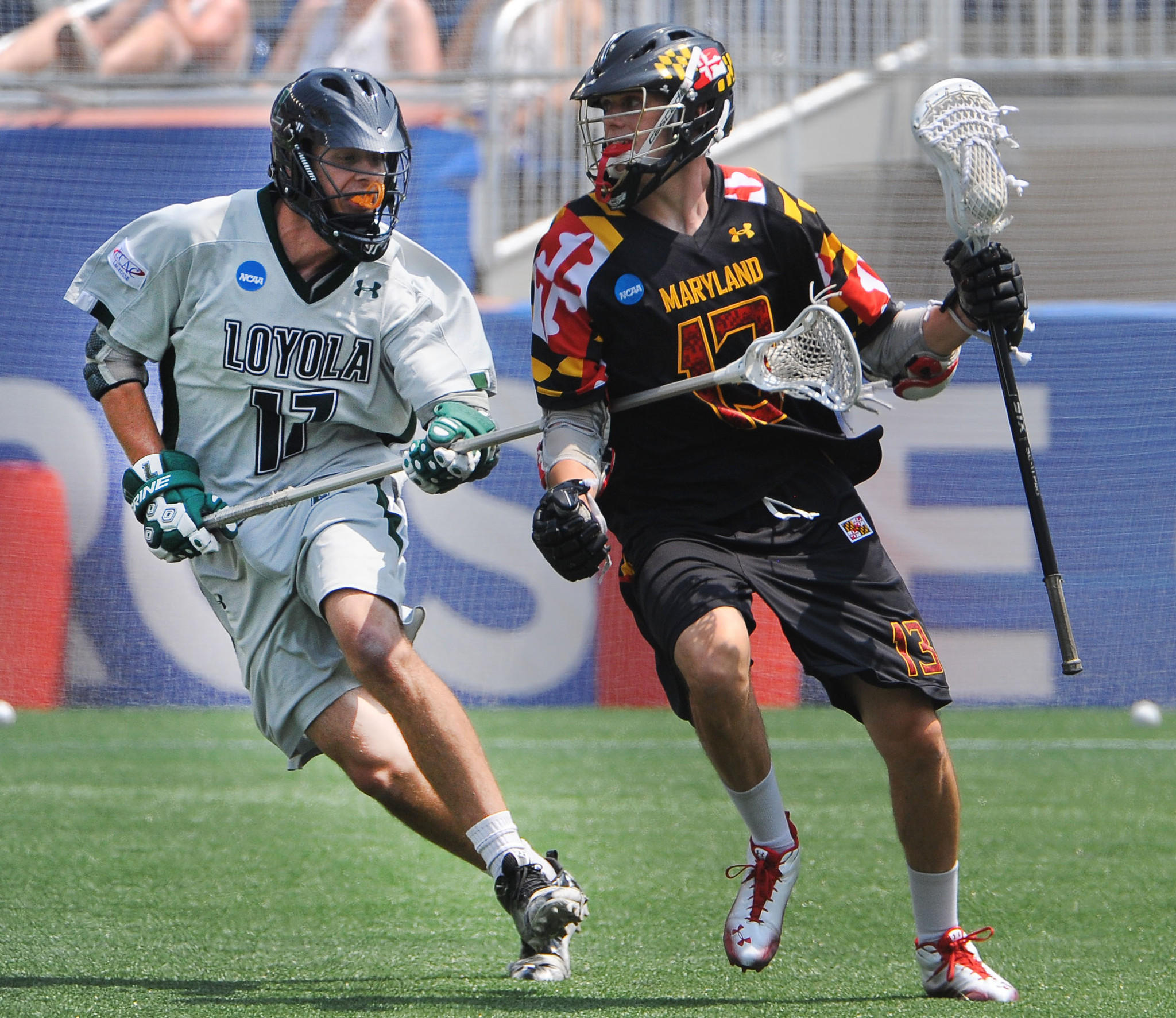 Loyola Maryland defenseman Joe Fletcher (left), challenging Maryland attackman Owen Blye during the 2012 national championship game in Foxborough, Mass., went third in the MLL draft Friday night.