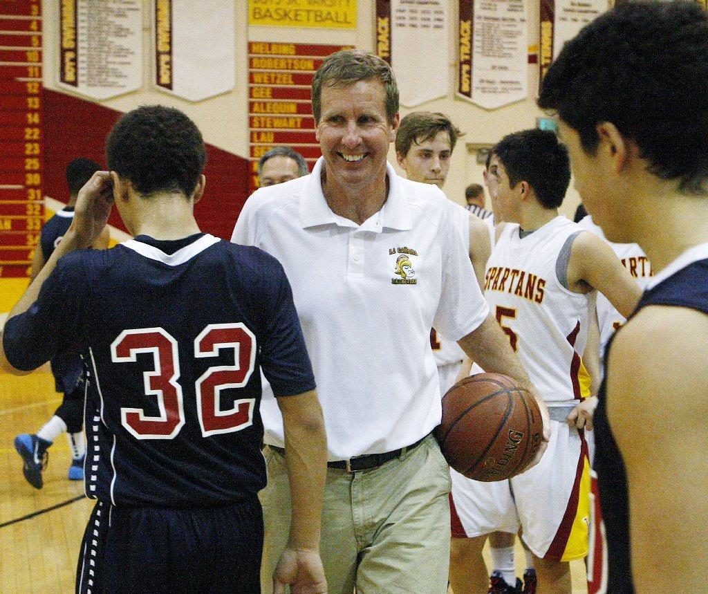 La Cañada High boys' basketball Coach Tom Hofman is all smiles after winning his 600th game in a nonleague boys basketball game against La Salle at La Cañada on Friday. (Tim Berger/Staff Photographer)