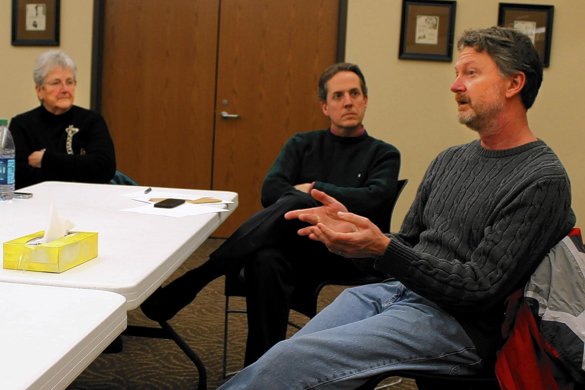 Local volunteer Peter Dudak spoke at a meeting of the newly-formed Warrenville Community Club as city clerk Emily Larson and Andy Johnson listened