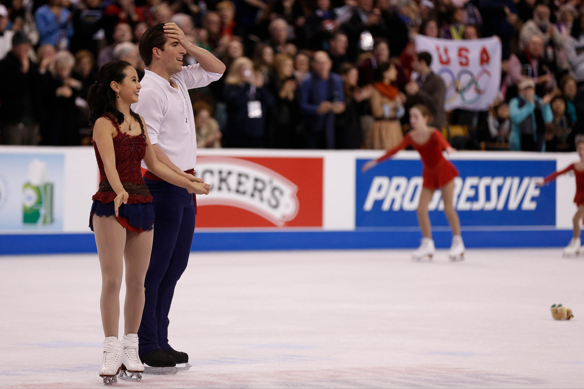 Nathan Bartholomay reacts with stunned delight after he and Felicia Zhang finished second in pairs at U.S. Figure Skating Championships.