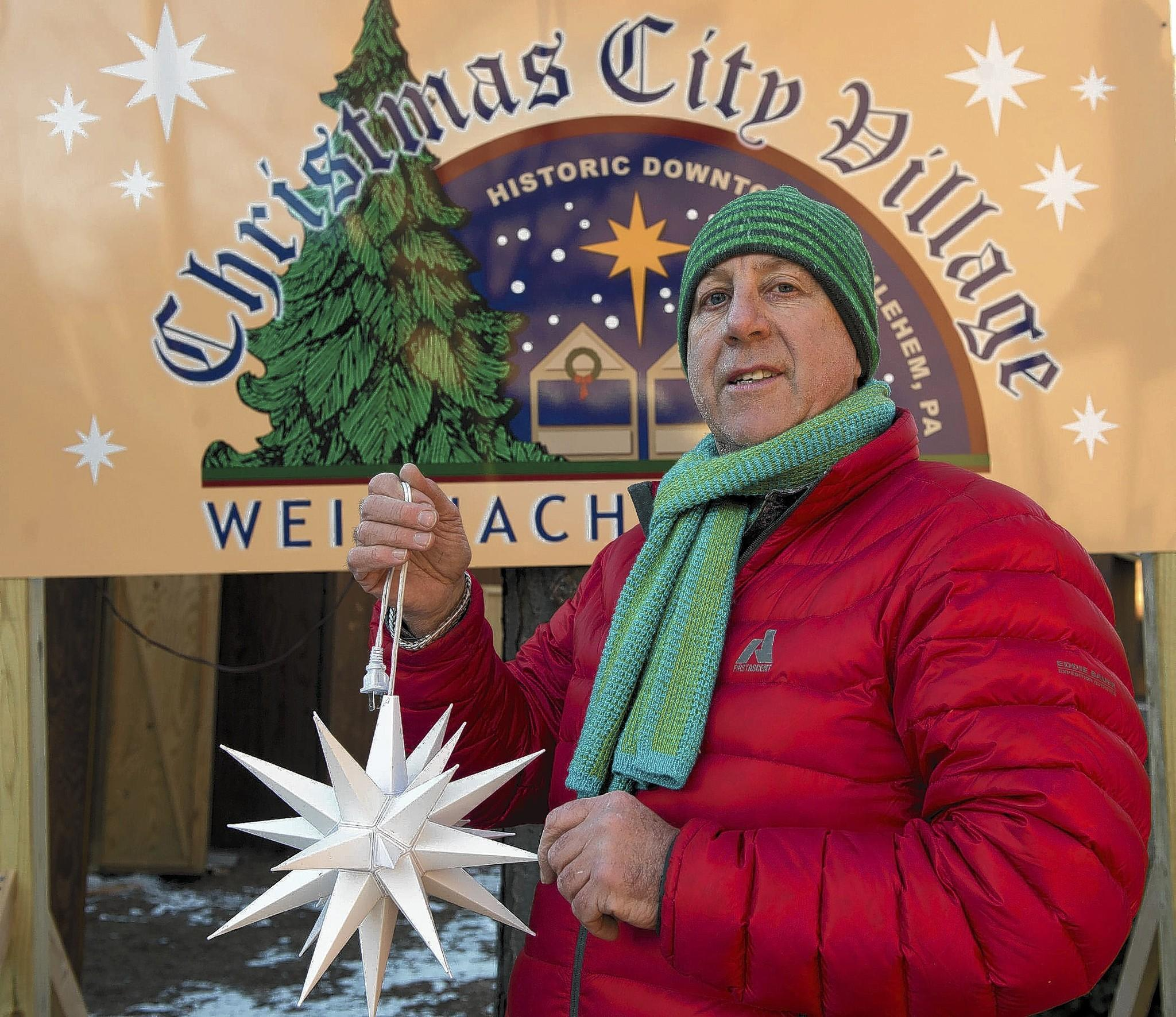 Donegal Square and McCarthy's Restaurant owner Neville Gardner poses at the Christmas Village in Bethlehem on Thursday.