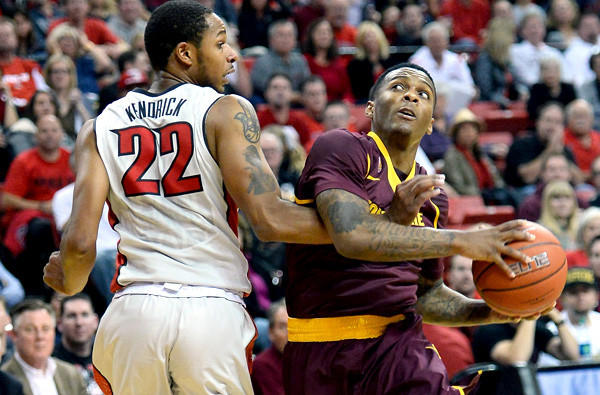 Arizona State point guard Jahii Carson drives to the basketball against UNLV's Jelan Kendrick during a non-conference game earlier this season.