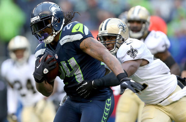 Seahawks running back Marshawn Lynch is tackled by Saints safety Roman Harper in an NFC divisional playoff game.
