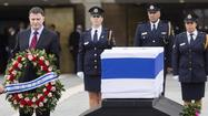 As Ariel Sharon lies in state, Israelis pay their respects