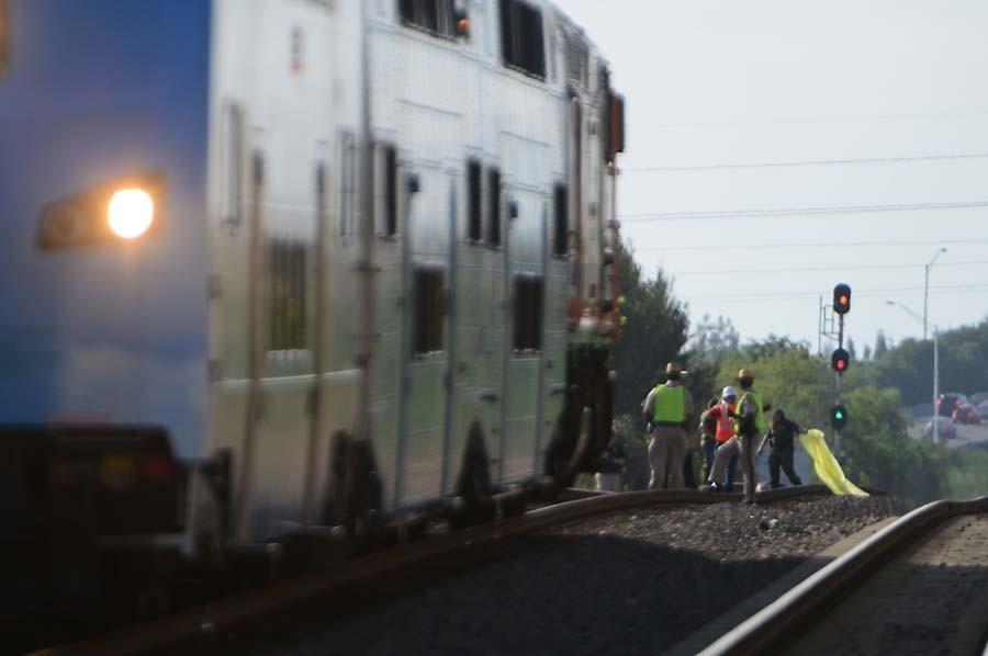 HALLANDALE TRAIN 0112A BSO investigators use a yellow sheet to cover the body of the victim of a Tri-Rail train vs. pedestrian accident Sunday, Jan 12, 2014, just south of Hallandale Beach Blvd., and west of I-95.Joe Cavaretta, SunSentinel (c)2014