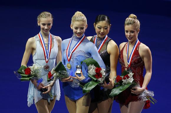 Polina Edmunds, Gracie Gold, Mirai Nagasu and Ashley Wagner during Saturday's awards ceremony at the U.S. Figure Skating Championships.  (Brian Snyder / Reuters)