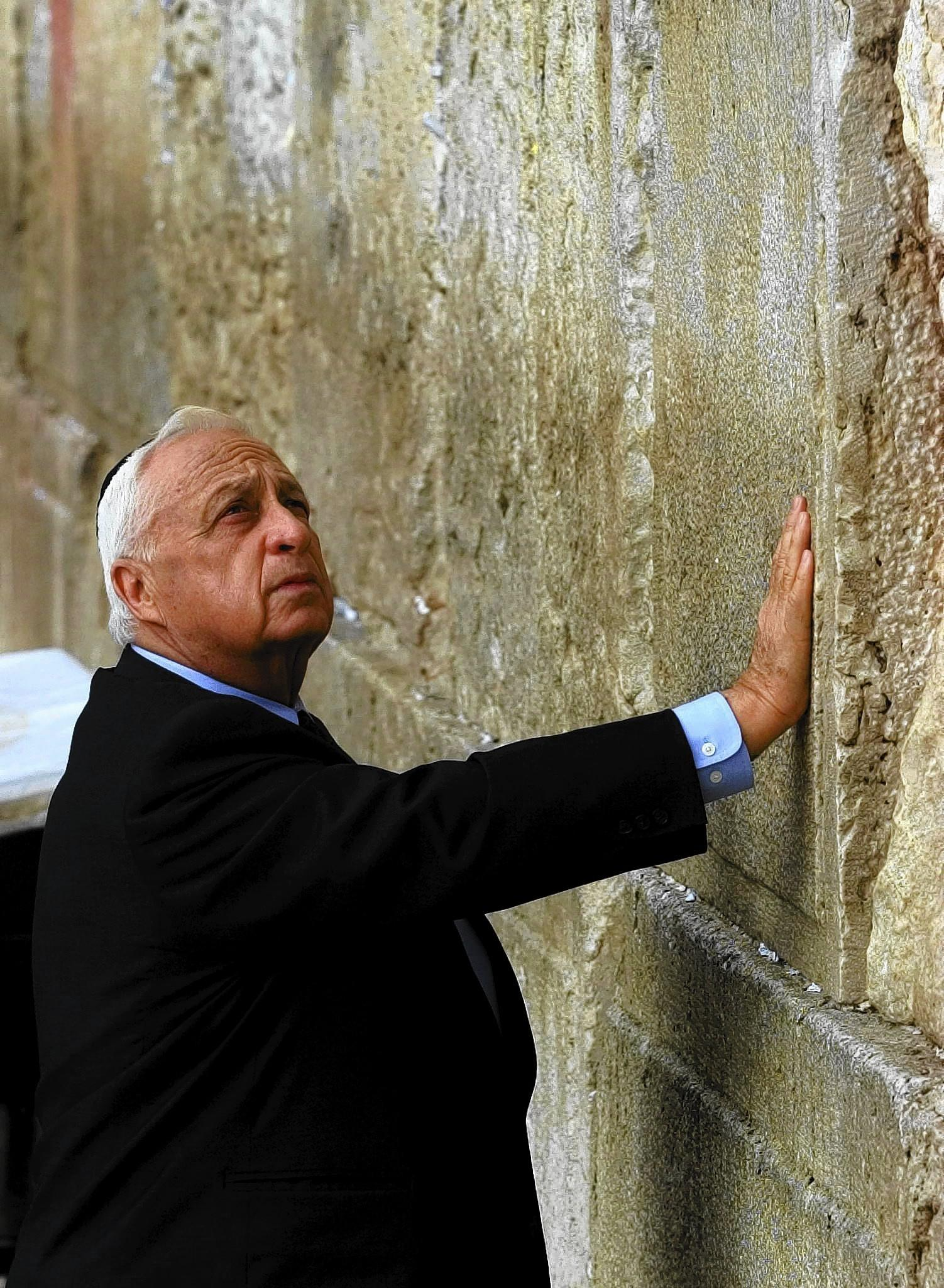 In 2001, then-Israeli Prime Minister Ariel Sharon prays at the Western Wall, Judaism's holiest site, in Jerusalem after being elected prime minister.