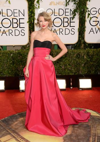 Taylor Swift achieves new but age-appropriate elegance in cherry red and black Carolina Herrera.