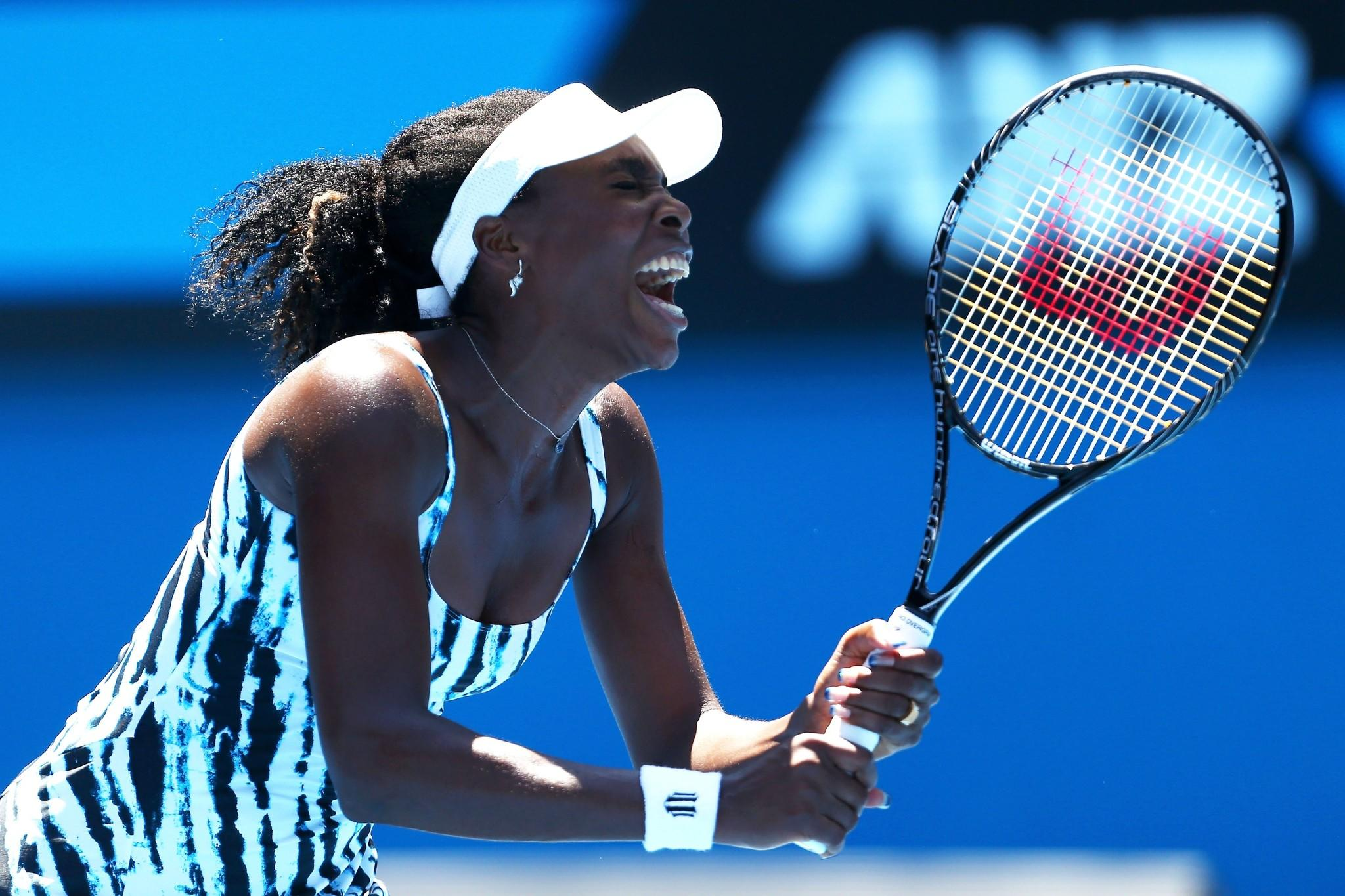 Venus Williams reacts in her first round match against Ekaterina Makarova.