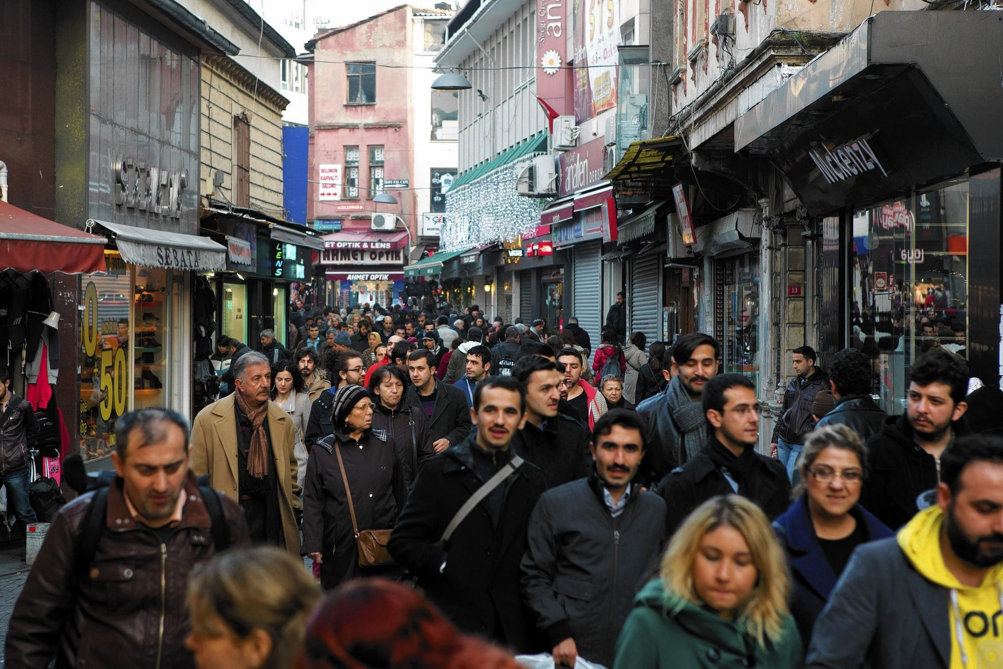 People walk past retail stores in Istanbul, Turkey, last week — a week when the nation's currency reached an all-time low.