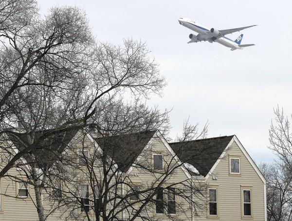 A jet heads west Sunday from O'Hare International Airport over homes in Bensenville, which made 127 noise complaints in November 2013.