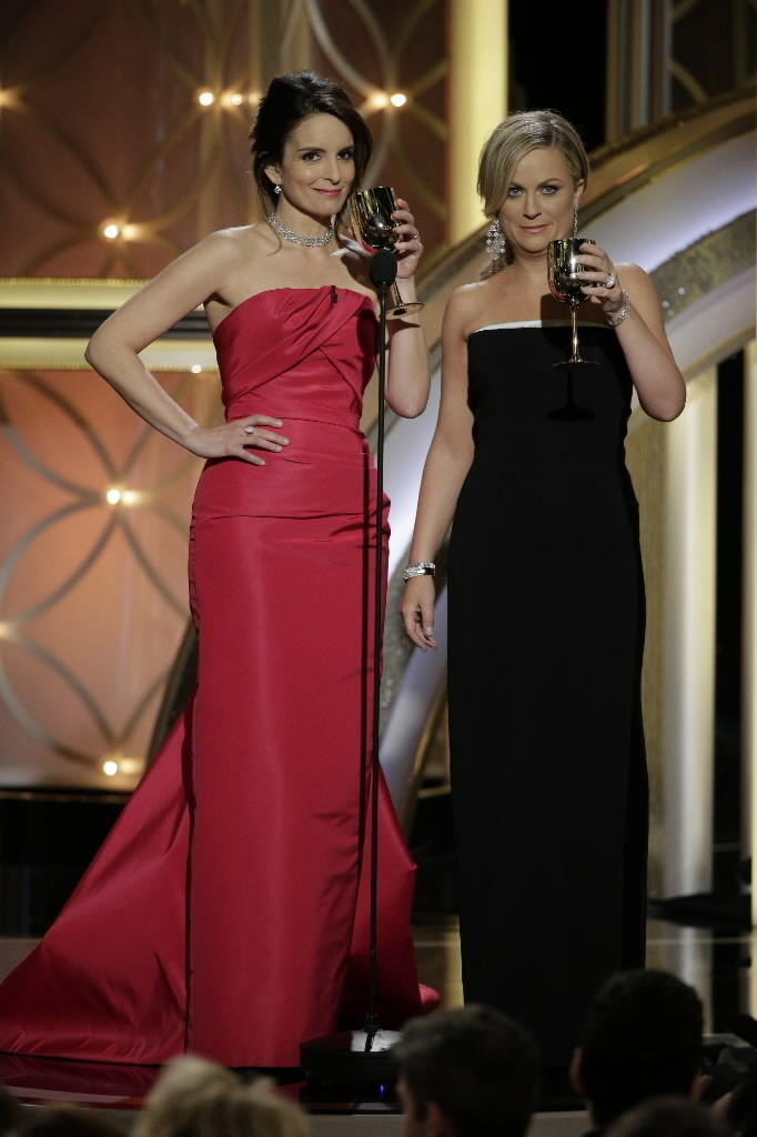 Tina Fey (left) and Amy Poehler host the Golden Globes on Sunday.