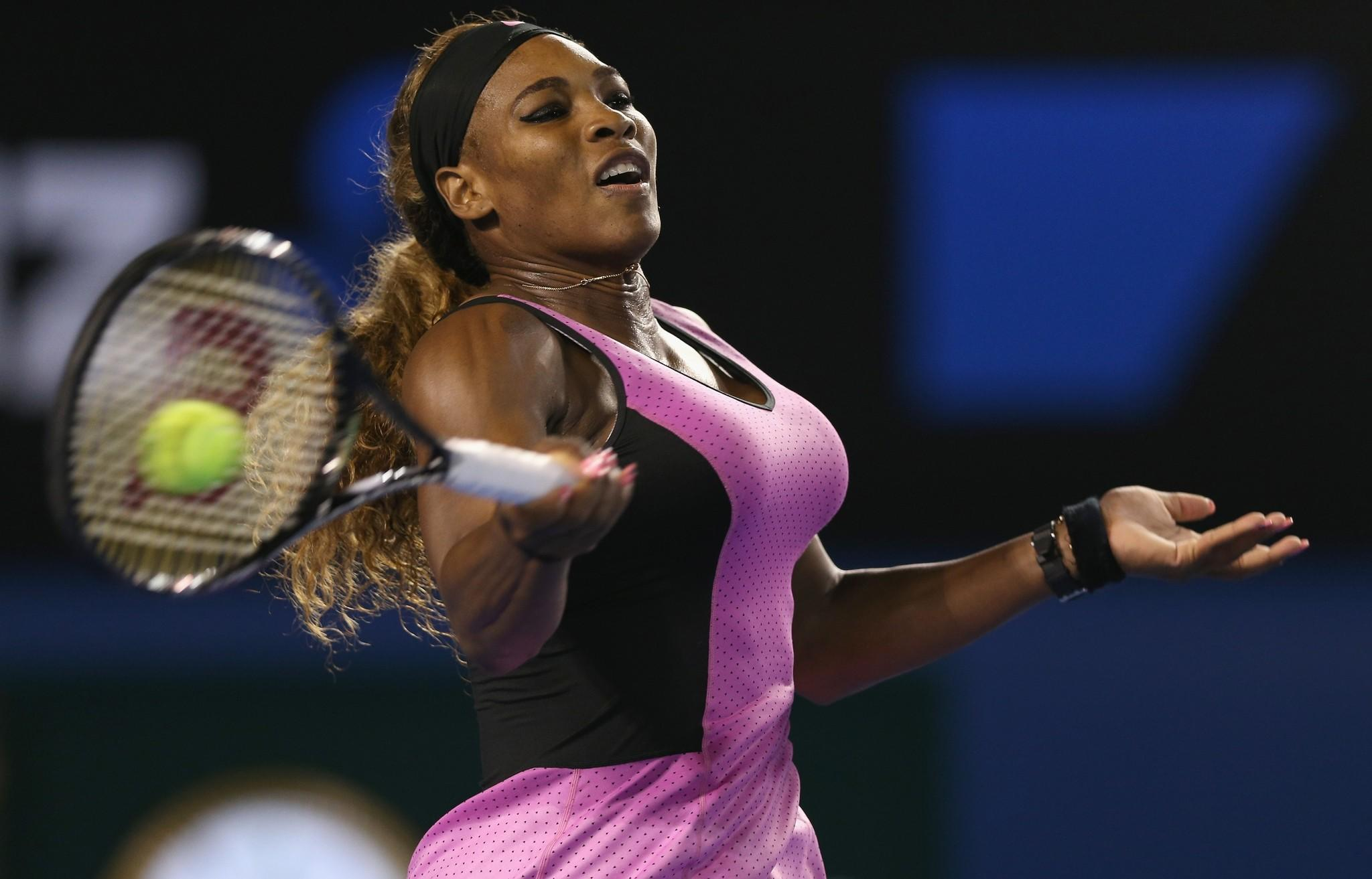 Serena Williams plays a forehand in her first round match against Ashleigh Barty of Australia.