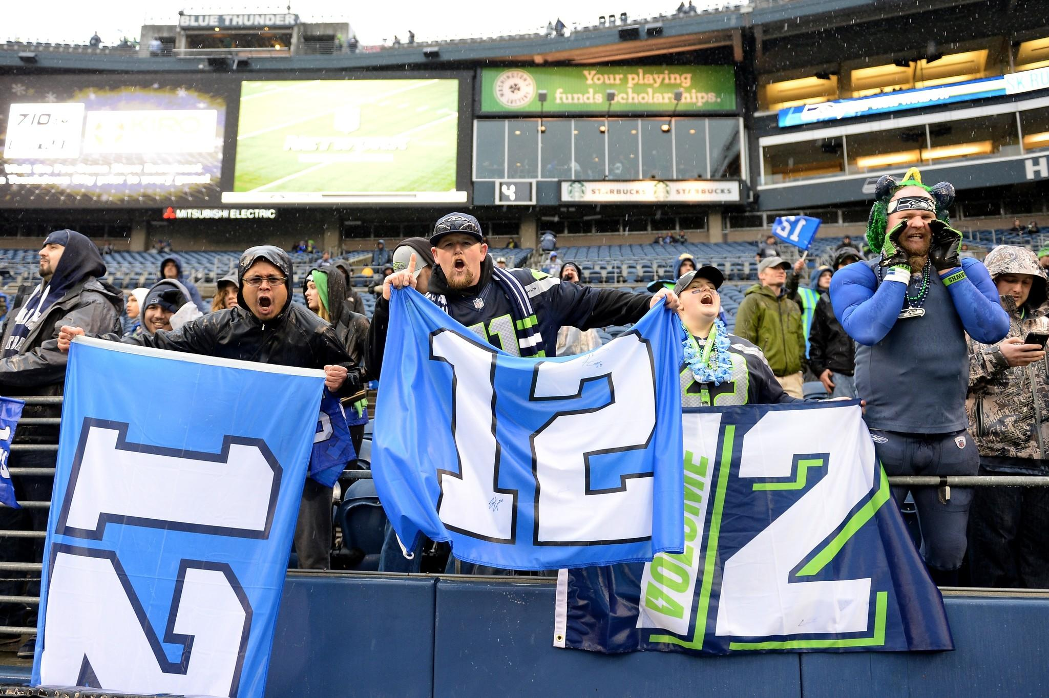 Seattle Sehawks fans hold up the 12th Man signs before the Seahawks take on the New Orleans Saints in the NFC Divisional Playoff Game at CenturyLink Field.