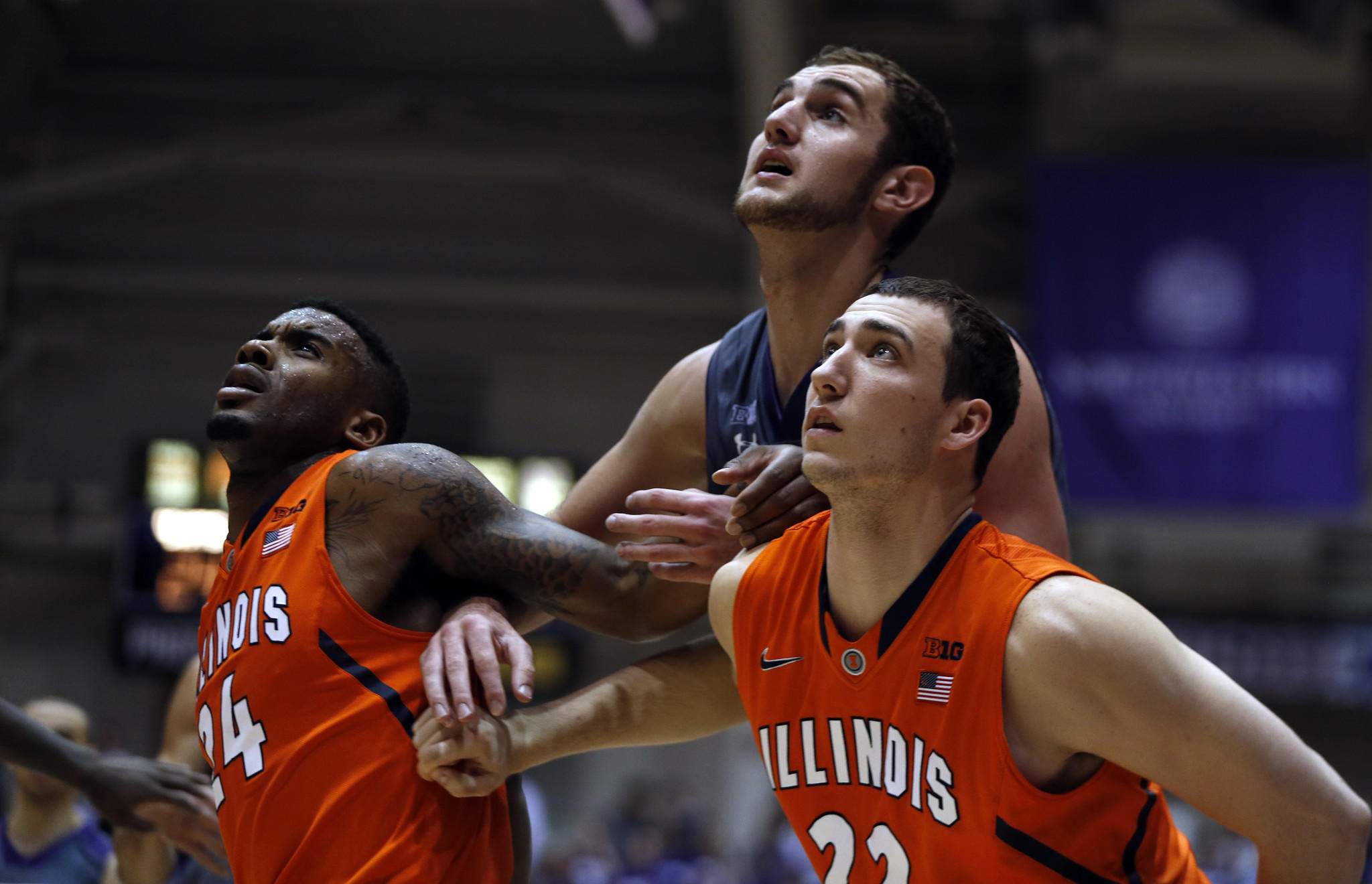 Illinois' Rayvonte Rice (24) and Maverick Morgan (22) box out Northwestern's Alex Olah during Sunday's game.